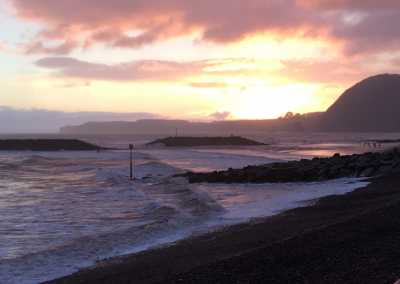 Stunning Sidmouth skies on a winter afternoon - sea, red skies, beach